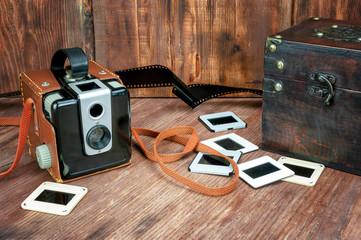Retro camera on wooden background