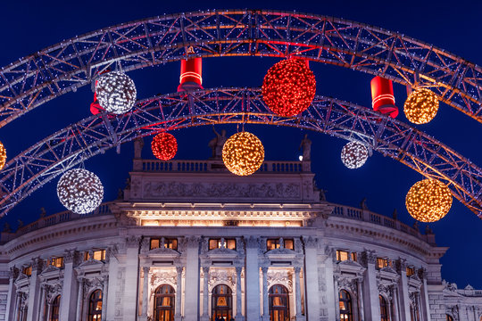 Festively decorated arc on Christmas market over Hofburgtheater