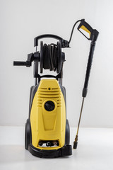 Yellow high pressure washer on white background
