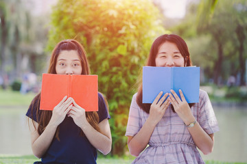 Education concept - Group of women are happy with the book outdoor, Learning on the Campus or university.