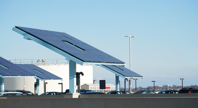solar panels at the parking lot near oil tank