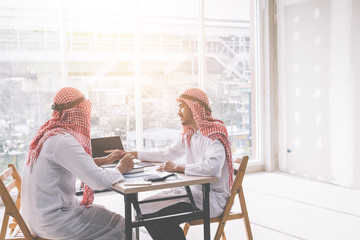 Two Arab business people working together in an office business project.