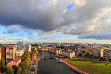 Cloudy weather in Kaliningrad. River Pregolya, Embankment of the Fish Village and the Jubilee Bridge. Russia, Kaliningrad