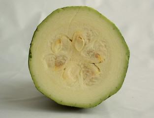 Cut zucchini on a white background