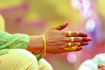 Indian wedding photography,Haldi ceremony groom hands