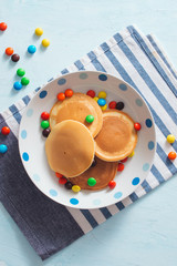 Children's breakfast or dessert - pancake with colorful candies.