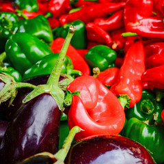 red, green peppers and dark eggplants closeup
