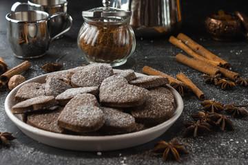 Vegan heart gingerbread cookies on dark background
