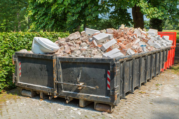 Debris container with stones and toilet