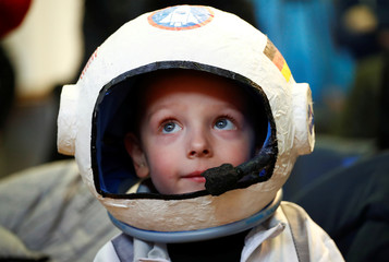 Four-year-old Joshua wears his self-made helmet before a news conference with German astronaut Alexander Gerst near Cologne