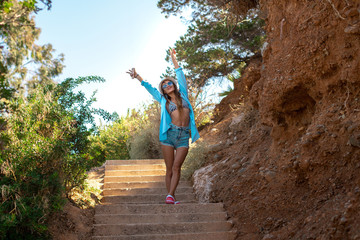 girl climbs on the stone stairs