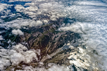 clouds over top  of Alps aerial view from airplane