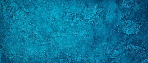 Banner of textured bright blue concrete background