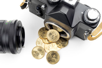 camera with dollars pouring from it on a white background