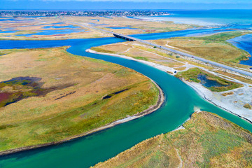 curved river and bridge from aerial view from drone