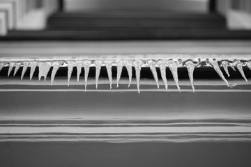 Black and white background with icicles on the building