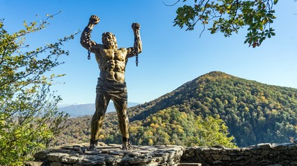 Prometheus sculpture on the backgroung of Ahun mountain, Sochi, Russia.