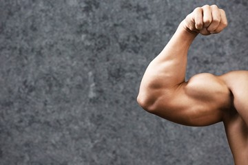 Cropped image of bodybuilder showing muscles