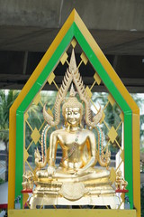 gold buddha statue with artifact green aura behind.