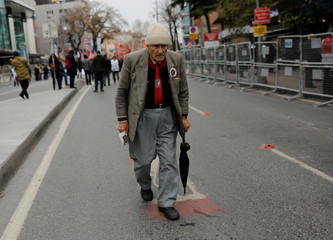 A man makes his way to a square to attend a protest against the economic policies of the government in Istanbul
