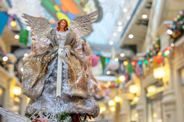 Statuette of a woman angel at the Christmas tree.