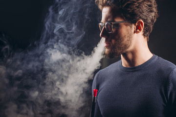 cool guy with smoke from nose. close up side view shot. resting time. hobby, relaxation close up side view shot. copy space