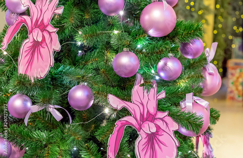Orchid Christmas Tree.Lilac Balls And Orchid Flowers On The Christmas Tree Stock