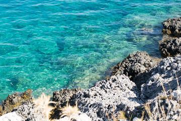 Beautiful turquoise sea with rocks  beach  , seascape