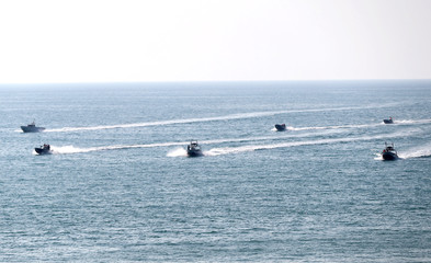 Military units of the IRGC Ground Force are seen on boats as they launched war games in the Gulf