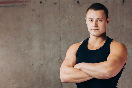 young awesome athlete looking at the camera indoors. close up photo. health and body care, copy space,fitness