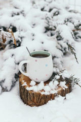 cup of tea on a snow background. xmas time