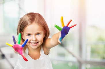 Cute little girl with colorful painted hands