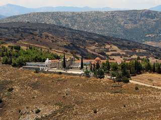 Europe, Greece, Peloponnese, on the sun-soaked  top of the hill is a beautiful monastery.