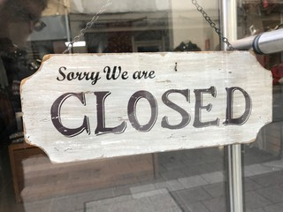 shop sign saying sorry we are closed