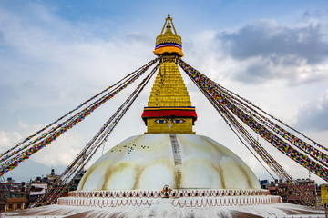 Landscape front view of Boudhanath Stupa and prayer flags. Kathmandu, Nepal. Boudha Stupa is one of the largest stupas in the world.