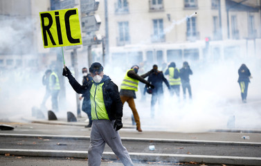 """A protester wearing a yellow vest attends a demonstration of the """"yellow vests"""" movement in Nantes"""