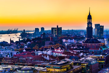Aerial view of the harbor, St. Michael's Church (German: St. Michaelis) and downtown Hamburg, Germany.