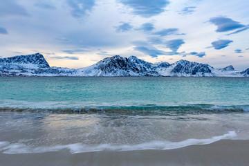 Norway, Lofoten Islands. Landscape in winter, beach and ocean waves