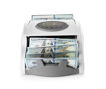 Modern electronic bill counter with money on white background