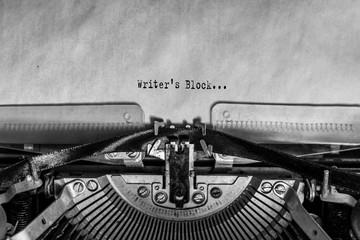 Writer's Block on a sheet of paper printed on a vintage typewriter. writer, journalist.