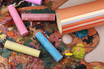 drawing crayons with paper on the palette