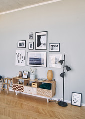 different size framed photos hanging on the gray wall.