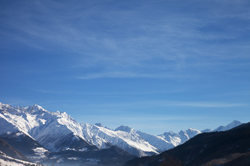 Fototapete - View on snowy mountains and beautiful blue sky in nice sunny morning