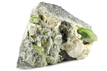 green sphene (titanite) with albite from Skardu, Pakistan isolated on white background