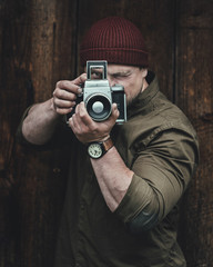 Professional photographer with vintage camera.