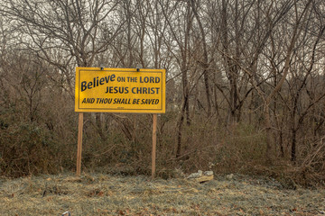 Religious sign posted in forest area