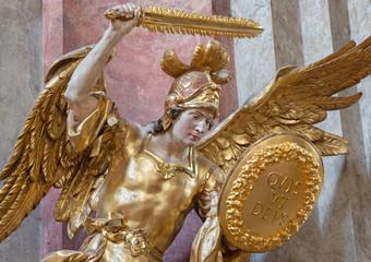 PRAGUE, CZECH REPUBLIC - OCTOBER 18, 2018: The carved polychrome statue of Archangel Michael in church Kostel Svaté Kateřiny Alexandrijské by Václav Vavřinec Reiner (1689 - 1743).