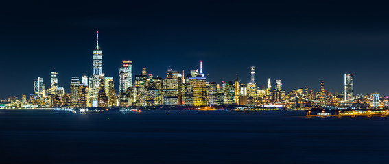 Wall Mural - New York City skyline panorama by night, as viewed from Staten Island