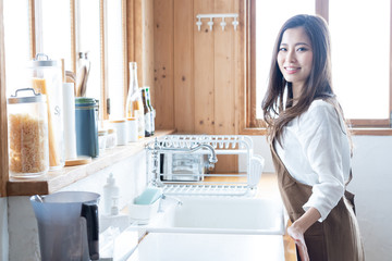 young asian woman in kitchen