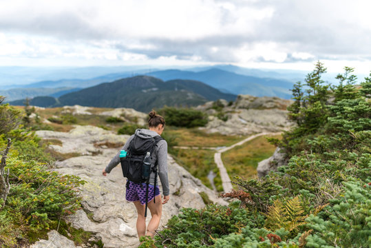 female hiker finds her footing hiking along Mount Mansfield in Vermont